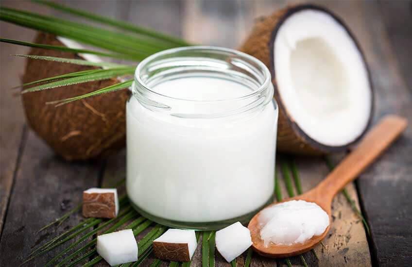 Foto kokosolje munnrens - naturlig hvite tenner